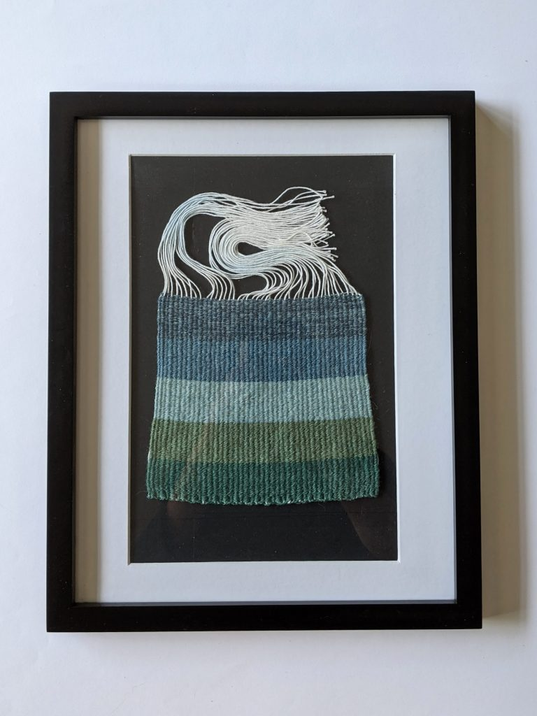 Title: Chomophobia Chromophelia Blue - Green  Dimensions: 12 x 15 inch frame  Medium: Wool dyed with natural pigments, plain weave  Price: $500